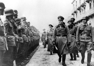 German Field Marshal Gen. Erwin Rommel reviews the crew of a German coastal battery on the English Channel Coast, England, in March 1944 during World War II. (AP Photo)